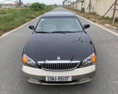 Bán xe cũ Daewoo Magnus 2.5 AT 2004, màu đen giá 129 triệu tại Hà Nội