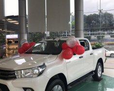 Bán Toyota Hilux 2.4E 4x2 MT sản xuất năm 2019, màu trắng, nhập khẩu  giá 622 triệu tại Quảng Ninh