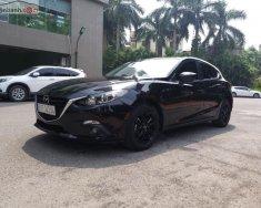 Cần bán gấp Mazda 3 1.5 AT sản xuất năm 2015, màu đen như mới giá 530 triệu tại Hà Nội