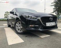 Cần bán xe cũ Mazda 3 1.5 AT đời 2018, màu đen giá 640 triệu tại Tp.HCM