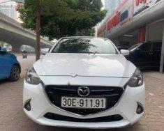 Xe Mazda 2 1.5 AT năm 2015, màu trắng chính chủ giá cạnh tranh giá 465 triệu tại Hà Nội