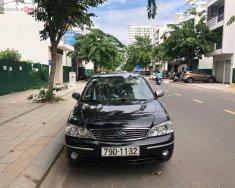 Bán Ford Laser GHIA 1.8 AT sản xuất 2004, màu đen, số tự động  giá 200 triệu tại Khánh Hòa