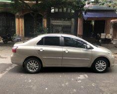 Nhà tôi bán xe Toyota Vios 1.5E sx 2011, màu ghi vàng, chính chủ gia đình từ đầu giá 265 triệu tại Hà Nội
