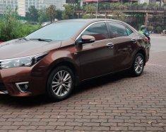 Bán xe Toyota Corolla altis 1.8 AT 2015, màu nâu giá 595 triệu tại Hà Nội