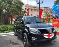 Cần bán xe Toyota Fortuner AT sản xuất 2016, màu đen số tự động giá 648 triệu tại Tp.HCM