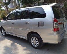 Cần bán Toyota Innova E đời 2014, màu bạc, chính chủ giá 420 triệu tại Tp.HCM