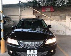 Cần bán gấp Mazda 6 2005, màu đen, nhập khẩu, xe gia đình giá 270 triệu tại Tp.HCM