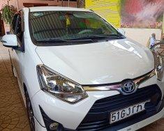 Cần bán gấp chiếc Toyota Wigo AT, đời 2018, màu trắng, xe nhập khẩu, xe còn mới giá 385 triệu tại Tp.HCM