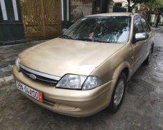 Bán Ford Laser đời 2005, màu vàng, xe nhập giá 93 triệu tại Hà Nội