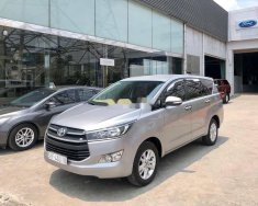 Cần bán xe Toyota Innova 2.0E đời 2017, màu bạc  giá 618 triệu tại Tp.HCM