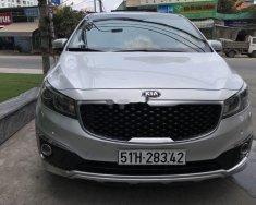 Xe Kia Sedona đời 2015, màu bạc, giá tốt giá 750 triệu tại Tp.HCM