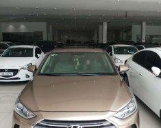 Bán xe Hyundai Elantra 2.0AT năm sản xuất 2016, màu vàng, số tự động giá 565 triệu tại Tp.HCM