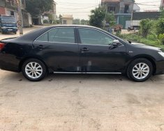 Cần bán lại xe Toyota Camry 2.0E đời 2013, màu đen chính chủ, giá tốt giá 629 triệu tại Hà Nội