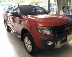 Cần bán gấp Ford Ranger Wildtrak 2.2 L sản xuất năm 2014, màu đỏ giá 525 triệu tại Tp.HCM