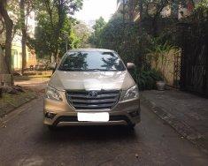 Tôi cần bán chiếc xe ô tô Toyota Innova 2.0E màu ghi vàng 2016 giá 425 triệu tại Hà Nội