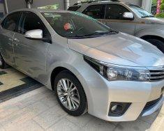 Cần bán Toyota Corolla altis 1.8G đời 2016, màu bạc, số tự động giá 650 triệu tại Tp.HCM