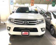 Cần bán gấp Toyota Hilux đời 2016, màu trắng, xe nhập, số tự động, giá 730tr giá 730 triệu tại Tp.HCM