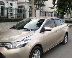 Bán xe Toyota Vios 1.5E màu cát, đời 2015, xe chính chủ còn mới nguyên giá 329 triệu tại Hà Nội