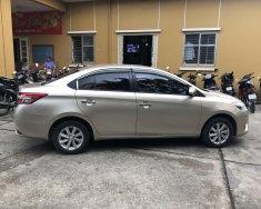 Cần bán gấp Toyota Vios E đời 2015, màu vàng, chính chủ, giá chỉ 309 triệu giá 309 triệu tại Hà Nội