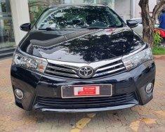 Cần bán xe Toyota Corolla altis đời 2015, màu đen giá 610 triệu tại Tp.HCM