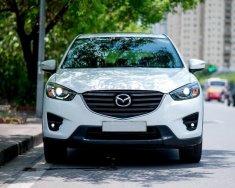 Nhà mình cần ra đi con Mazda CX5 2.5 đời 2016, số tự động, một cầu, bản full, màu trắng giá 687 triệu tại Tp.HCM