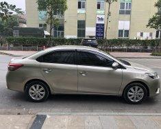 Chính chủ bán Vios E 2015, màu nâu vàng, gia đình sử dụng giá 315 triệu tại Hà Nội