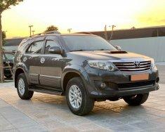 Nhà cần bán Toyota Fortuner G 2014, màu xám, số sàn giá 628 triệu tại Tp.HCM