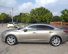 Mình cần bán Mazda 6 2017, tự động 2.5, màu vàng cát giá 656 triệu tại Tp.HCM