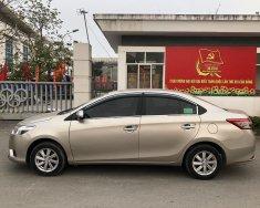 Gia đình bán xe Toyota Vios E màu vàng, sx 2015, chính chủ sử dụng giá 319 triệu tại Hà Nội