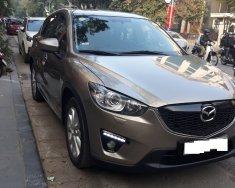 Gia đình cần bán Mazda CX5 2015, màu vàng cát giá 595 triệu tại Hà Nội