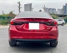 Nhà mình đang cần bán Mazda 6 2016 2.5AT bản full màu đỏ giá 665 triệu tại Tp.HCM