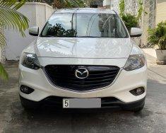 Gia đình cần bán Mazda CX9 tự động 2014 màu trắng bản full rất mới giá 866 triệu tại Tp.HCM