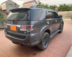 Tôi cần bán Toyota Fortuner 2016, số sàn, máy dầu, màu xám chì giá 693 triệu tại Tp.HCM