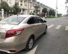Gia đình bán xe Vios E màu vàng, sx 2015, chính chủ từ đầu. giá 318 triệu tại Hà Nội