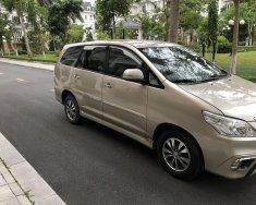 Chính chủ sử dụng bán xe Toyota Innova 2.0E màu vàng, sx 2015 giá 366 triệu tại Hà Nội