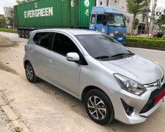 Nhà tôi cần bán xe Toyota Wigo 2018, số sàn, màu bạc giá 282 triệu tại Tp.HCM
