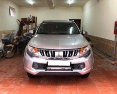 Mình cần bán xe Mitsubishi Triton 2016, số tự động, máy dầu, màu bạc giá 453 triệu tại Tp.HCM