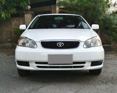 Gia đình bán Toyota Altis 2003, số sàn, màu trắng giá 225 triệu tại Tp.HCM
