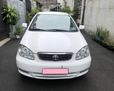 Về hưu cần bán Toyota Altis G 2004, số sàn, màu trắng giá 235 triệu tại Tp.HCM