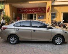 Gia đình bán xe Vios E màu nâu vàng, sx 2015, chính chủ tên tôi giá 306 triệu tại Hà Nội