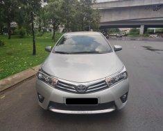 Cần bán xe Toyota Altis 1.8G 2015 màu bạc chính hãng Toyota Sure giá 580 triệu tại Tp.HCM